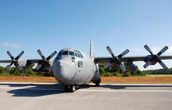 US Air Force transport airplane. C-130 Hercules parked in remote airfield royalty free stock photography