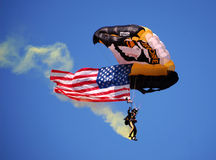 US Airborne parachutist above UM-MSU game Royalty Free Stock Images