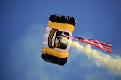US Airborne parachutist above UM-MSU game Stock Photography