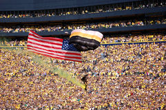 US Airborne parachutist travels past the crowd at Royalty Free Stock Photo
