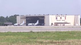 US Aircraft In Front Hangar. Two US aircrafts  standing in front of a hangar at a US Airbase stock footage