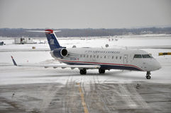 US Airways Express in airport after snow Royalty Free Stock Photography