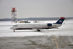 US Airways Express in airport after snow Stock Photo