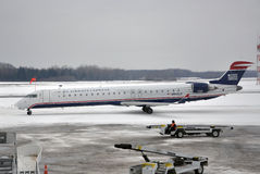 US Airways Express in airport after snow Royalty Free Stock Photos