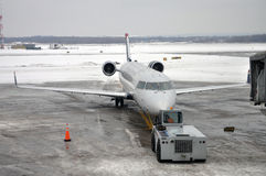 US Airways Express in airport after snow. Syracuse, New York State Royalty Free Stock Images