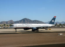 US Airways passenger jet in Phoenix, AZ. Phoenix, USA - September 29, 2013: US Airways Boeing 757 passenger jet arrives in its home base of Phoenix, Arizona royalty free stock photo