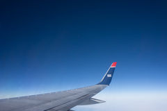 US Airways. PHILADELPHIA - MAY 26, 2014: An US Airways flight from Philadelphia to Lisbon. US Airways is owned by American Airlines and operates both stock photography