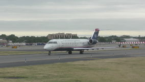 US Airways regional jet. Charlotte, USA - June 5: US Airways regional jet departs from Charlotte, NC on June 5, 2015. The fleet is slowly being repainted into stock video footage