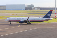 US Airways 757. Side view of US Airways Boeing 757 taxiing at Schiphol Amsterdam Airport stock images