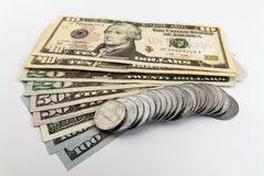 US american dollar money bills and coins cents spread on white b Stock Photography
