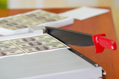Us american dollar money bills printed in a sheet of paper in a paper cutter. Manufacture work Royalty Free Stock Photos