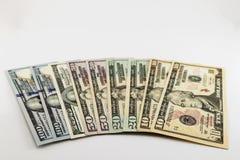 US american dollar money bills spread on white background Stock Photos