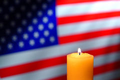 US American Flag and Commemorative Candle Burning Stock Images