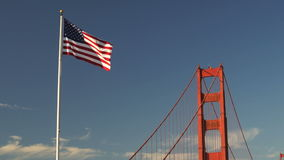 US American Flag Waving Golden Gate Bridge National Recreation Area stock video