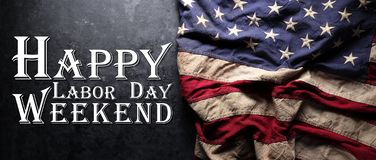 US American flag on worn black background. For USA Labor day celebration. With Happy Labor Day Weekend