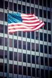 US american symbol flag over blue modern city buildings Stock Images
