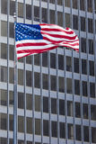 US american symbol flag over blue modern city buildings Royalty Free Stock Images