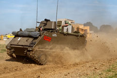 US APC in dust arena. WESTERNHANGER, UK - JULY 18: An ex M113 Bradley armoured troop carrier is driven around the main arena for the public to watch at the W&P Royalty Free Stock Photo