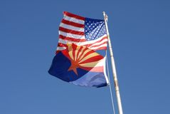 US and Arizona Flags. Against blues sky Royalty Free Stock Photos
