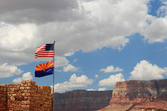 US and Arizona flags fly near Marble Canyon Royalty Free Stock Photography