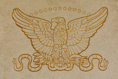 US armed forces golden eagle emblem. US armed forces military golden eagle emblem at World War two cemetery Cambridge England Royalty Free Stock Photo