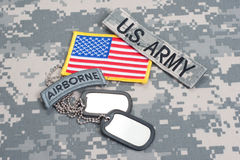 US ARMY airborne tab with blank dog tags on camouflage uniform. Concept Royalty Free Stock Images