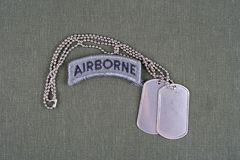 US ARMY airborne tab with dog tag on olive green uniform. Background Royalty Free Stock Photography