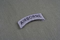 US ARMY airborne tab on olive green uniform. Background Stock Photo
