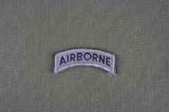 US ARMY airborne tab on olive green uniform. Background Stock Photography