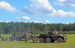 US Army attacking with armored cars. PILSEN, CZECH REPUBLIC - AUGUST 28: US Army attacking with armored cars during a demonstration at the Pilsen airshow on Royalty Free Stock Image