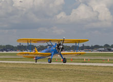 US Army Bi Plane Fighter starting on runway Royalty Free Stock Photos