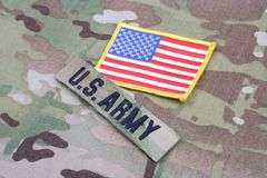 US ARMY branch tape with flag patch on camouflage uniform. Background Stock Photos