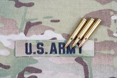 US ARMY branch tape and 5.56 mm rounds on uniform. US ARMY branch tape and 5.56 mm rounds on camouflage uniform Stock Photography