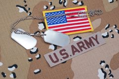 US ARMY concept with dog tags on camouflage uniform Stock Photos