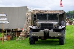 US Army Dodge WC Series Truck. A WWII US Army Dodge WC Series Truck next to an army tent with signposts. Scene was part of the M5 Living History Show at stock photography
