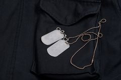 Us army dog tags. On black m65 field jacket Royalty Free Stock Images