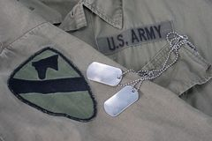 Us army dog tags. On uniform background Stock Image