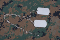 Us army dog tags on uniform. Us army camouflaged uniform with blank dog tags Stock Photo