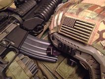 US army equipment. Still life: M4A1 carbine with M203 grenade launcher, vest and tactical Ops-Core helmet stock photos