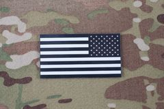 US ARMY flag patch on camouflage uniform. Background royalty free stock images