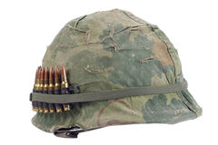 US Army helmet with camouflage cover and ammo belt - Vietnam war period stock images
