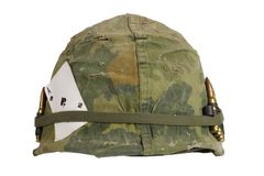 US Army helmet Vietnam war period with camouflage cover and ammo belt and amulet the ace of spades playing card Stock Photography