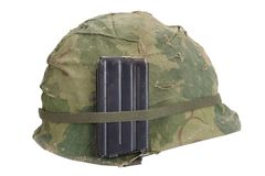 US Army helmet Vietnam war period with camouflage cover, magazine with ammo isolated. On white stock image
