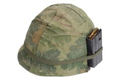 US Army helmet Vietnam war period with camouflage cover, magazine with ammo royalty free stock photo