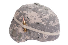 Us army kevlar helmet with camouflage cover with ammo amulet Stock Photos