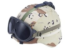 Us army kevlar helmet with a desert camouflage cover and protective goggles Royalty Free Stock Images