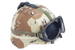 Us army kevlar helmet with a desert camouflage cover and protective goggles Royalty Free Stock Image