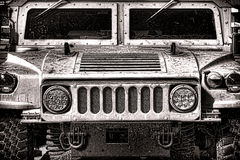 US Army Military Humvee Vehicle Front. US Army High Mobility Multipurpose Wheeled Vehicle Humvee military automobile light vehicle front hood grille and royalty free stock photos
