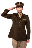 US army officer in saluting his senior. Young military officer saluting national flag Stock Images