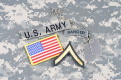 US ARMY Private rank patch, ranger tab, flag patch,  with dog tag on camouflage uniform Royalty Free Stock Photo
